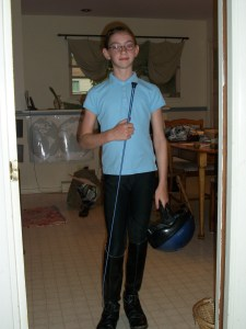 "R all decked out in her riding gear - ""new"" boots, crop and breeches!"